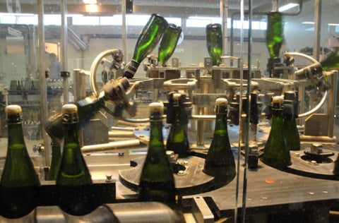 Champagne disgorgement line at Pol Roger