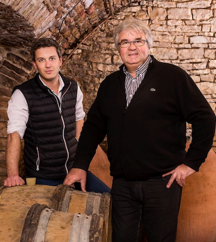 Champagne Gallimard Pere et Fils - Arnaud and his father in front of their barrels and amphorae in their cellars