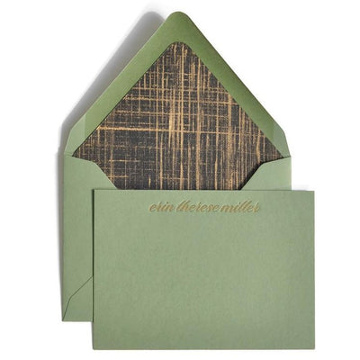 Green notecard with gold letterpress