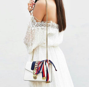Woman Wearing Gucci Sylvie Leather Mini Chain Bag