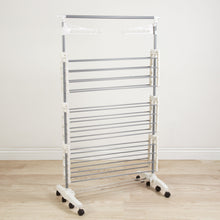 Load image into Gallery viewer, Order now heavy duty 3 tier laundry rack stainless steel clothing shelf for indoor outdoor use with tall bar best used for shirts towels shoes everyday home