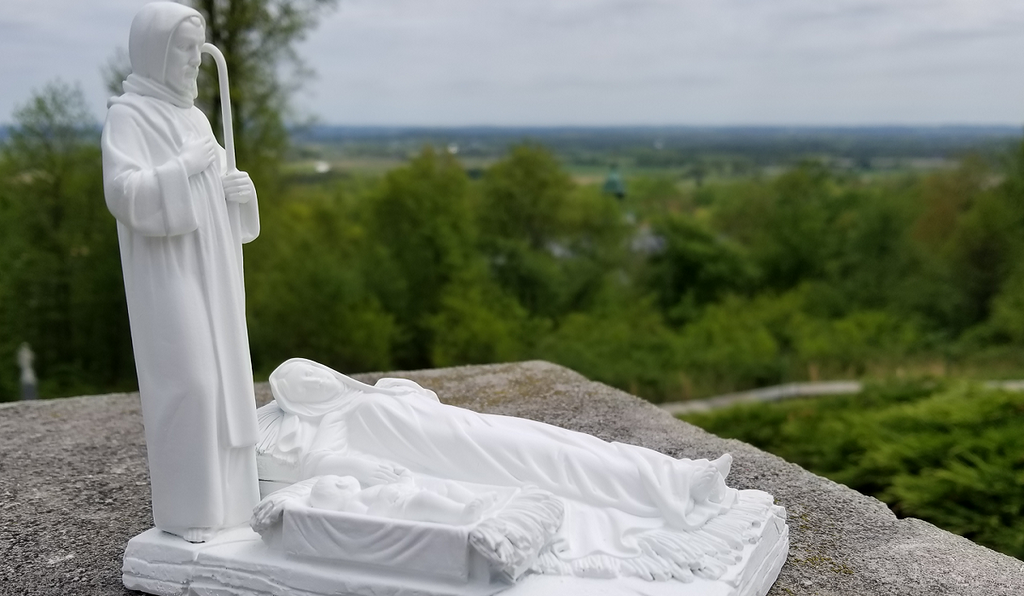 White statue for the right to life at the National Shrine Grotto overlooking the Maryland landscape