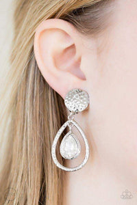 Paparazzi Centennial Charm - White Rhinestone Hammered Silver Teardrop Clip On Earrings - Bling It On Online