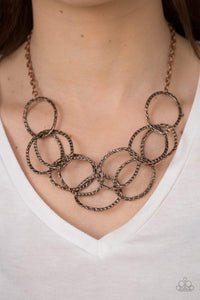 Paparazzi Circus Royale - Asymmetrical Hammered Interlocking Copper Ring Necklace - Bling It On Online