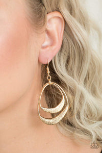 Paparazzi Follow The Beaten Path - Textured Asymmetrical Gold Hoop Earrings - Bling It On Online