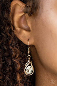 Paparazzi HAUTE On Your Heels! - Flame Pattern Oval White Rhinestone Gold Earrings - Bling It On Online