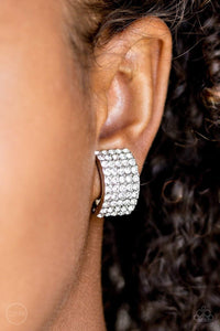 Paparazzi Hollywood Hotshot - White Rhinestone Encrusted Silver Clip On Earrings - Bling It On Online