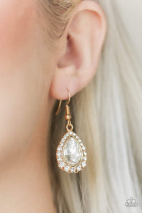 Paparazzi Self-Made Millionaire - Gold Teardrop White Gem Earrings - Bling It On Online