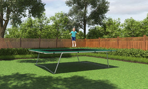 boy jumping on 9x15 trampoline with green frame pads