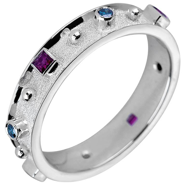 18 Karat White Gold Band Ring with Rubies and Blue Diamonds