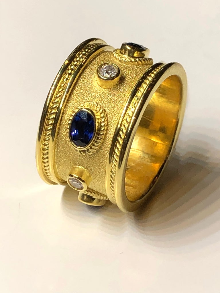 18 Karat Yellow Gold Diamond and 1.30 Carat Sapphire Ring