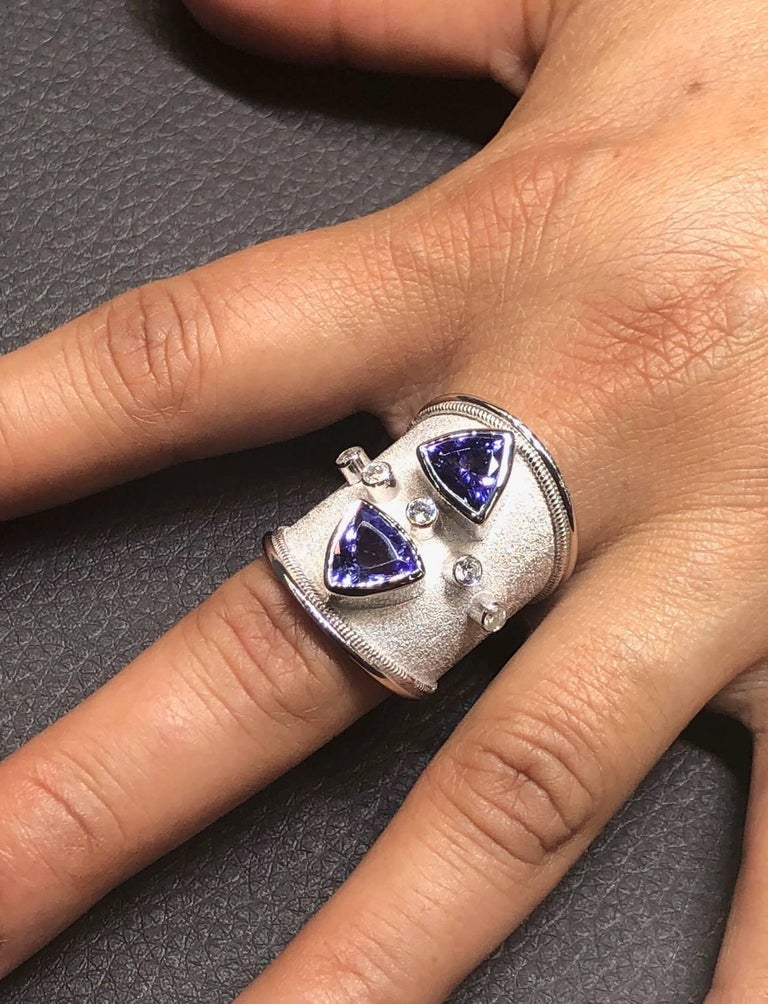 18 Karat White Gold Diamond Ring with Tanzanite Trilliants