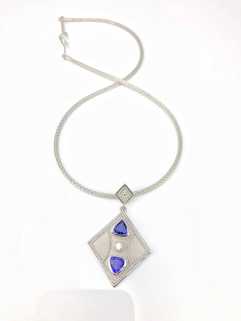 18 Karat White Gold Tanzanite and Diamond Pendant