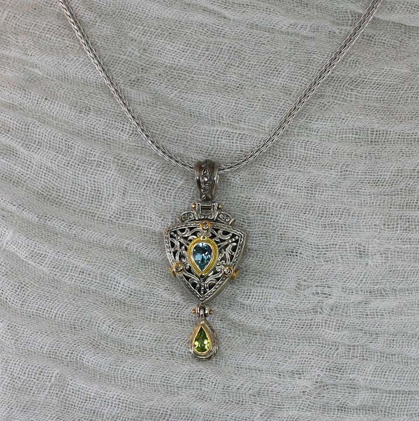 18 Karat Gold and Silver Aquamarine and Peridot Pendant