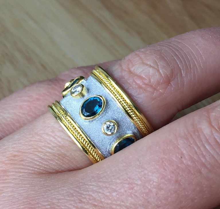18 Karat Yellow and White Rhodium Diamond and Topaz Ring