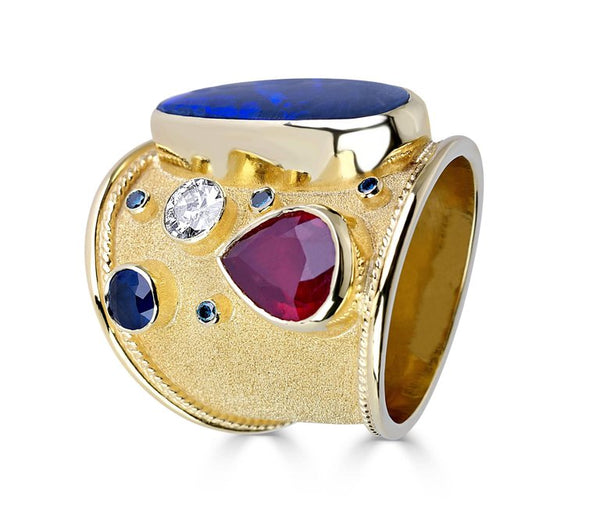 18 Karat Gold Ring with Opal Ruby Sapphire and Blue Diamond