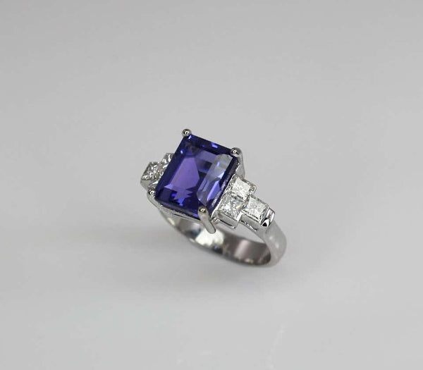 18 Karat White Gold Emerald Cut Tanzanite and Diamond Ring