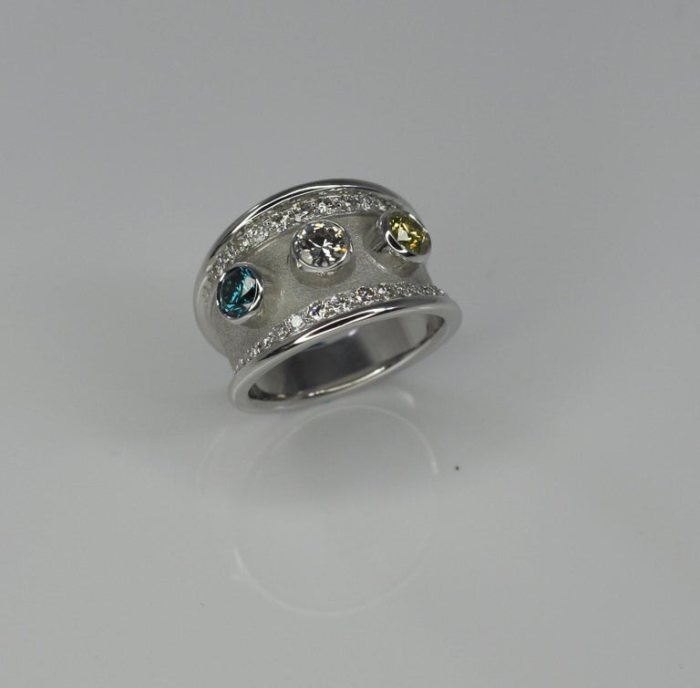 18 Karat White Gold Ring with Yellow Blue White Diamond