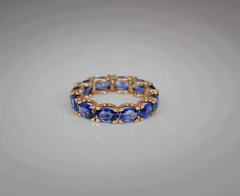 18 Karat Rose Gold Natural Blue Sapphire Eternity Band Ring