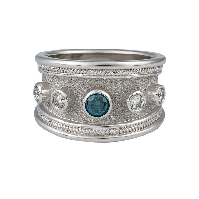 18 Karat White Gold Blue Center and White Diamond Band Ring