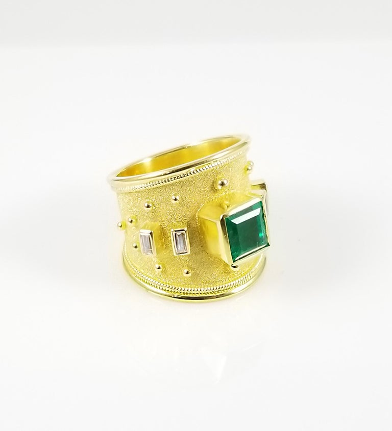 18 Karat Yellow Gold Emerald Ring and Emerald Cut Diamonds