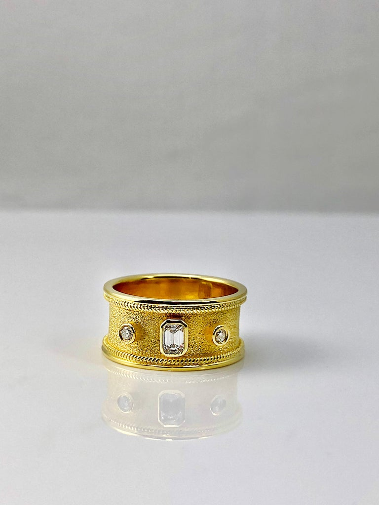 18 Karat Yellow Gold Diamond Band Ring Emerald Cut Diamond