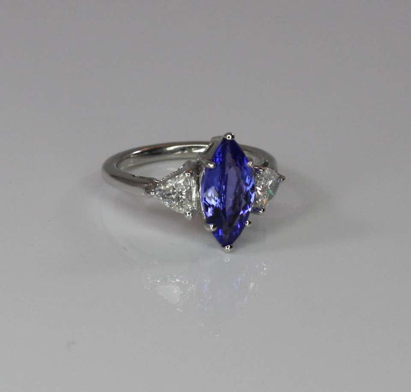 18 Karat White Gold Tanzanite Solitaire and Diamond Ring