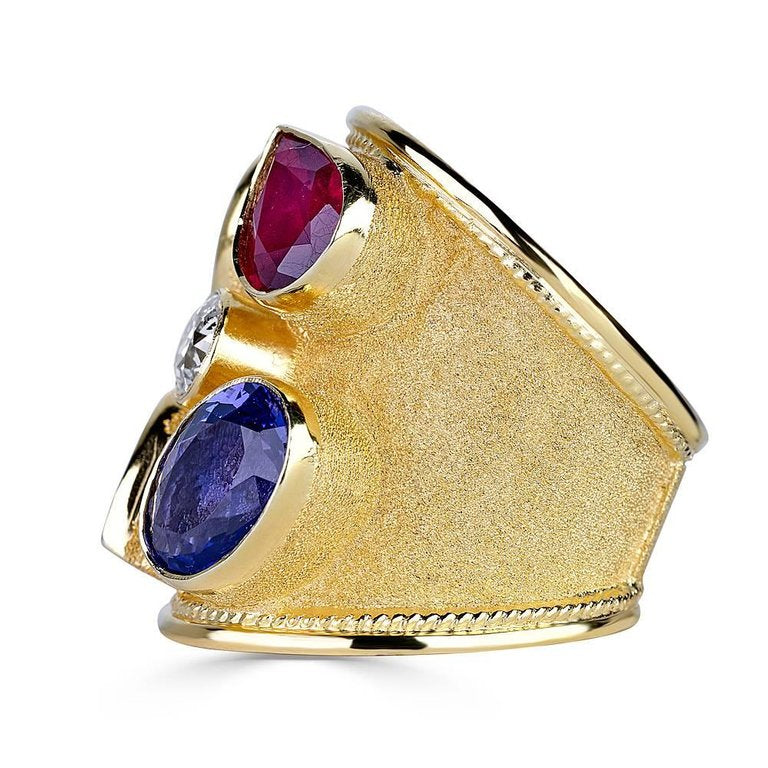 18 Karat Yellow Gold Diamond Tanzanite and Ruby Thick Ring