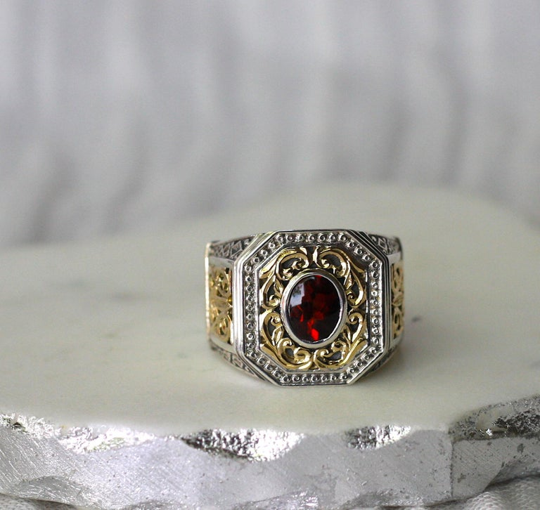18 Karat Gold and Silver Ring with Garnet