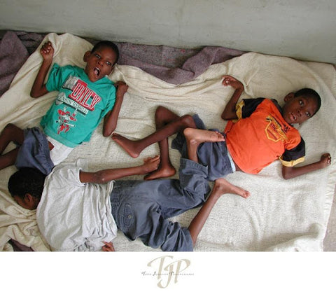 Mustard Seed Charity Children on Bed