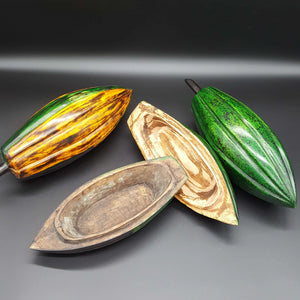 Jewelry Cocoa Pods, carved from native sese wood.