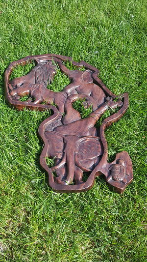 Africa Outlining Safari Animals, carved from native sese wood.