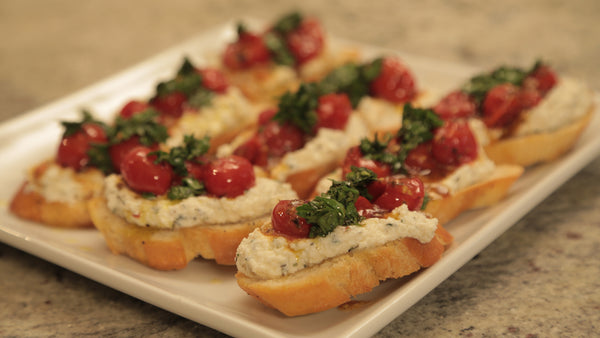 Cooked Holiday: Tomato Ricotta Crostini