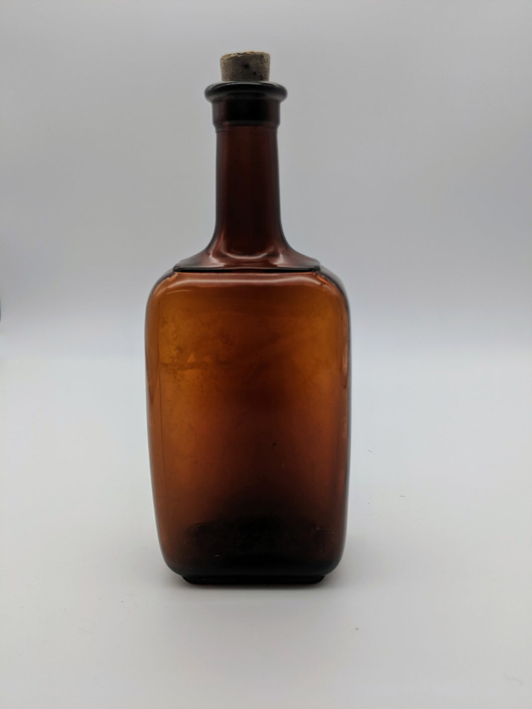 Amber Brown Antique Bottle with Cork