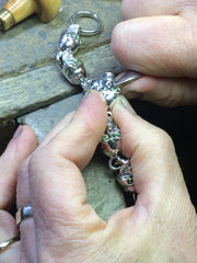 BSetting stones into a bracelet