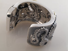 Double Dragon Cuff in Sterling, 18kt. Backside view.
