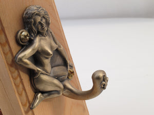 Bronze Jada Pin Up Hook, depicts exotic dancer Jada of New Orleans in the 1960's