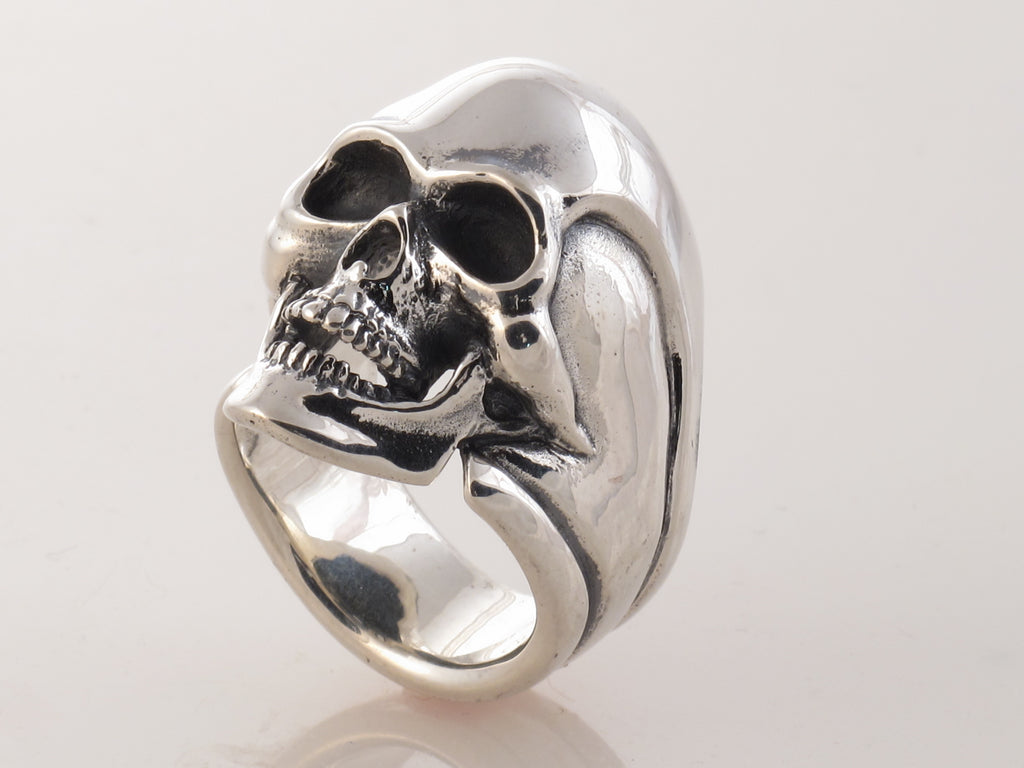 """#DR - 12 Sterling Skull ring as seen from the front angle view."""