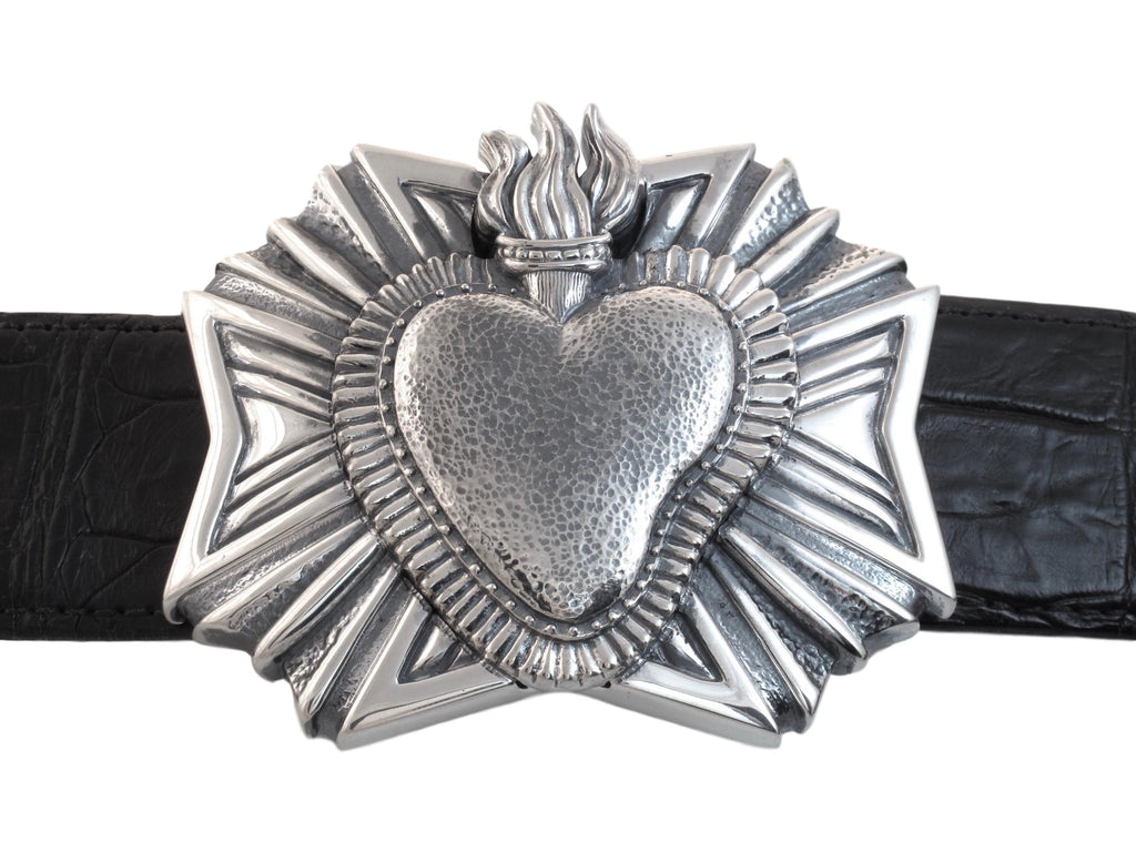 "Front on view of the sterling Heart Milago buckle. Shown on a black 1.5"" strap."