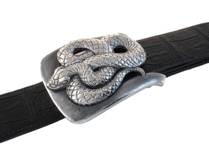 Angled top view of sterling Coiled Snake buckle on a black Alligator belt.