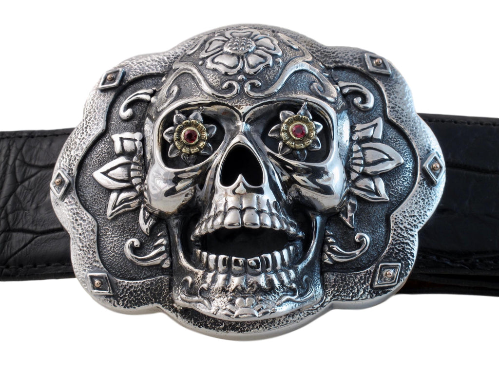 Front view of the Sugar Skull Trophy buckle in sterling and floral eyes set with Rubies in 18k bezel settings.