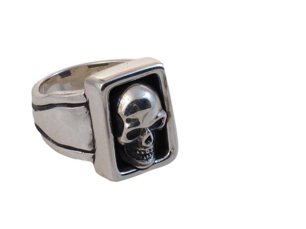 """Large Skull Boxed Ring, sterling seen from an angle."""
