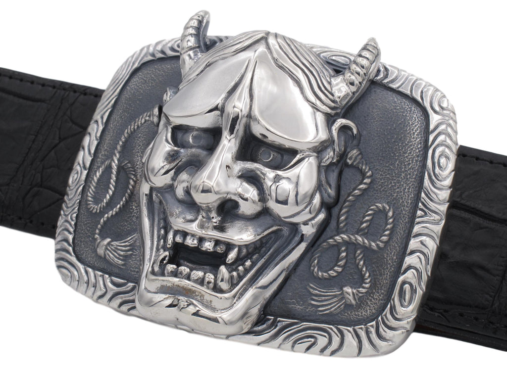 "Angled view of the Hanya Mask Trophy Buckle on a black alligator 1.5"" strap"