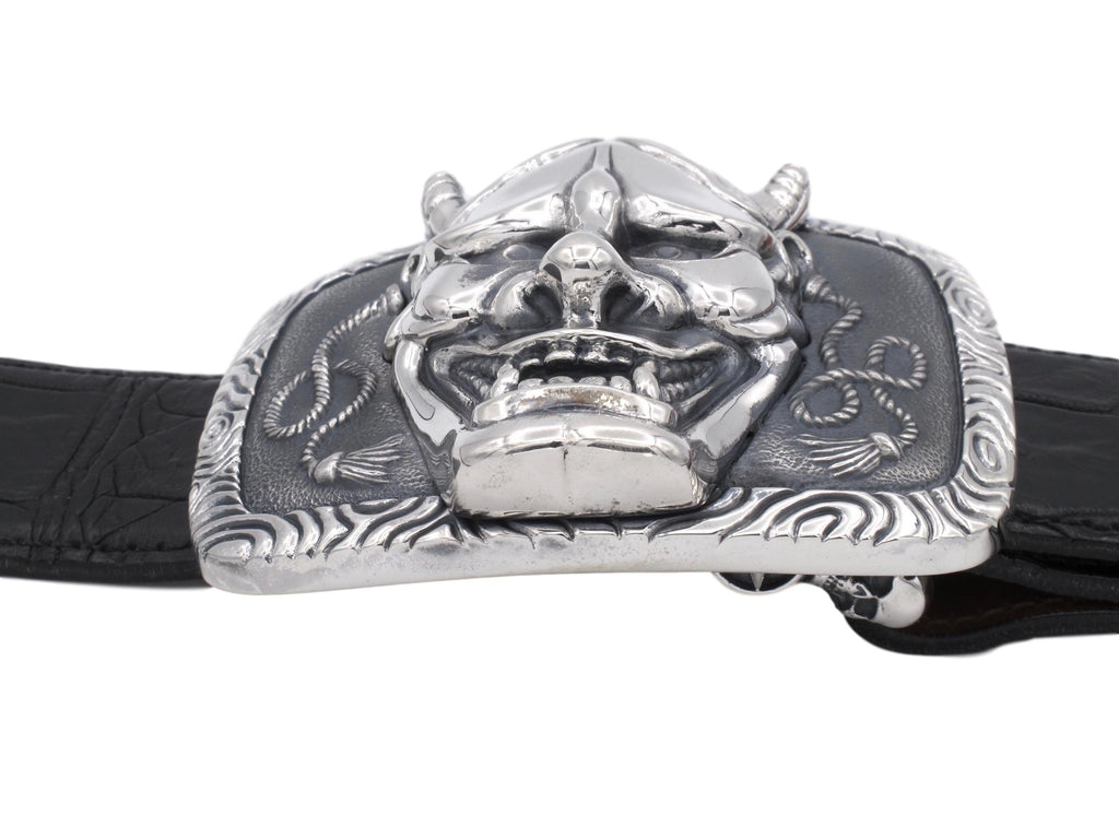 Side view of the Hanya Mask buckle in sterling. This view clearly shows the bold elevation of the mask on the buckle base.
