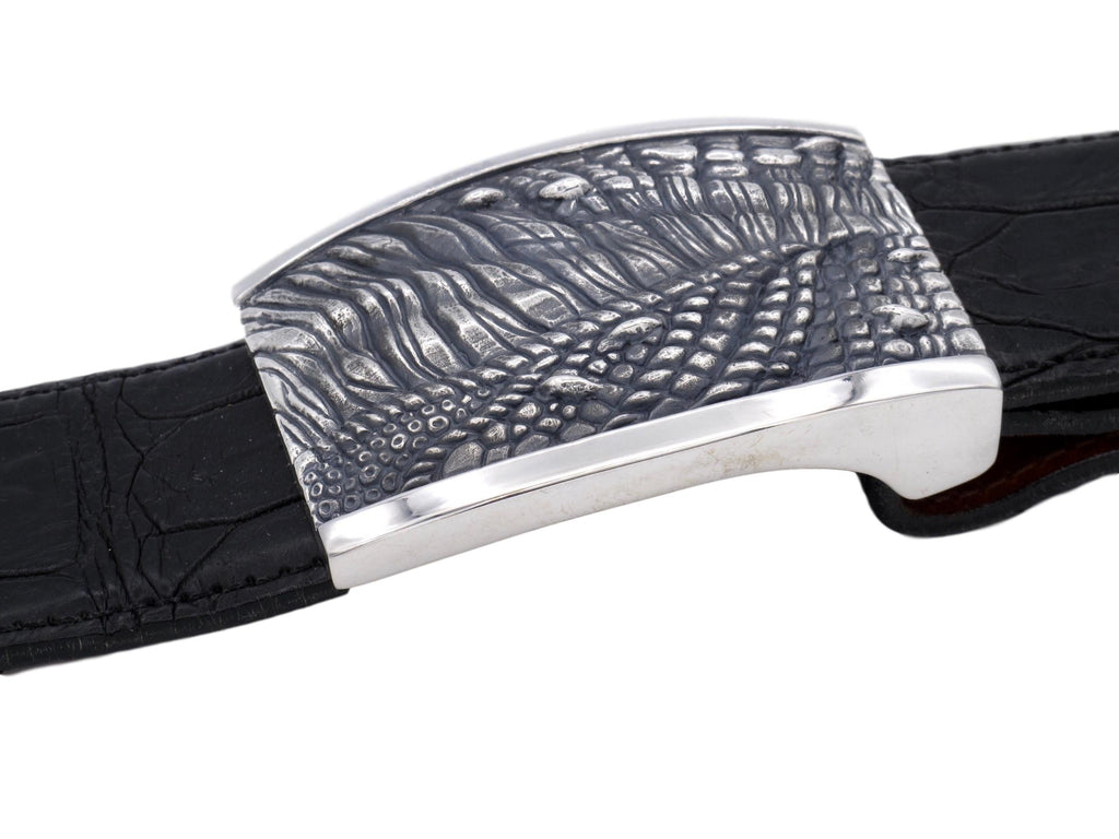 Side view of the sterling T Rex Skin plaque buckle on black alligator strap.