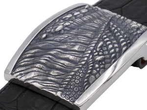 Angled view from above of the sterling T Rex Skin Plaque buckle showing the deep texturing of the carved donosaur skin in contrast to the smooth polished edges.