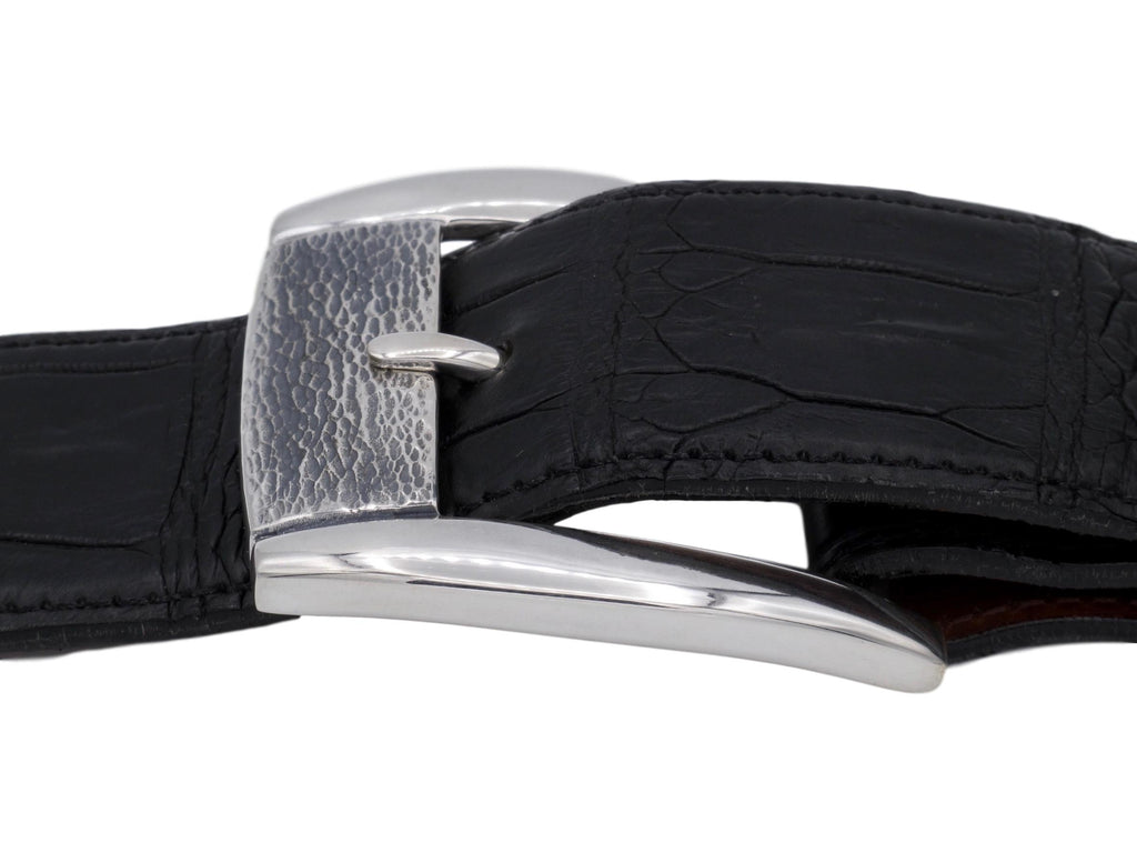 Side view of Sterling Textured Front Dress buckle on a black alligator strap.