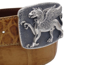 Angular view of the Sterling Griffin buckle with a coiled tan alligator strap.