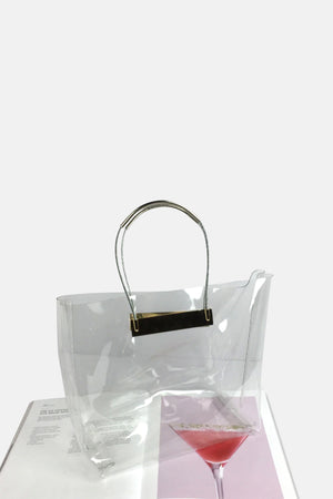METAL HANDLE TRANSPARENT BAG WITH GOLD DETAIL