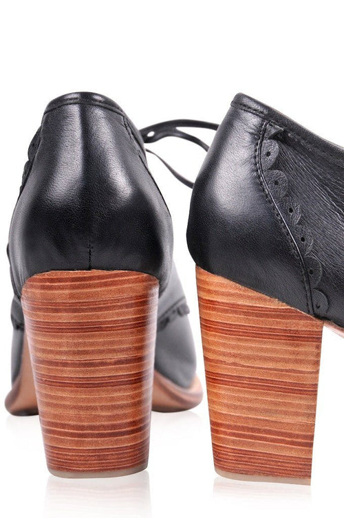 Wooden heel leather booties